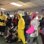 The Cheez werkers model their costumes