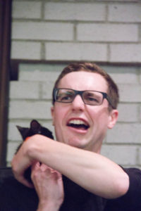Panelist Craig Wheat meets a member of the Itty Bitty Kitty Committee